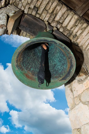 Bell in old colonial church. Ancient village Altos de Chavon - Colonial town reconstructed in Dominican Republic