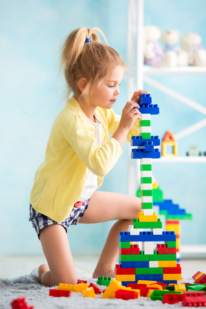 the girl built a tower of cubes. The joy of games.