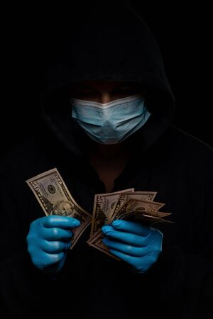 Concept of the global financial crisis. World pandemic virus COVID-19 coronavirus. Panic, black and shadow business and speculation. Stockfoto