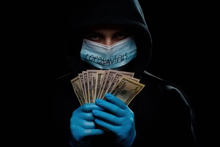Concept of the global financial crisis. World pandemic virus COVID-19 coronavirus. Panic, black and shadow business and speculation. Stock Photo