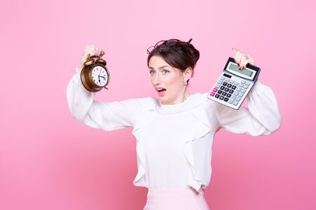 Young woman with a clock and a calculator in her hands panics from rush and lack of time. How to do everything. The problem of time management.
