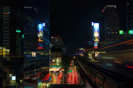 BANGKOK, THAILAND - OCTOBER 25, 2014: Night view from BTS Siam station connecting Sukhumvit and Silom lines. The station is located on Rama I Road to the west of Pathum Wan intersection in the heart of Siam District.