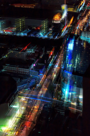 Blurred abstract background lights, beautiful top view of Bangkok City at night photo