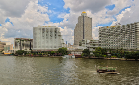 BANGKOK, THAILAND - OCTOBER 26, 2014: Daylight view from Taksin Bridge of Sathon District, Bangkok, Thailand. Below the bridge the Sathorn pier offers the service of Chao Phraya Express boats and ferry.