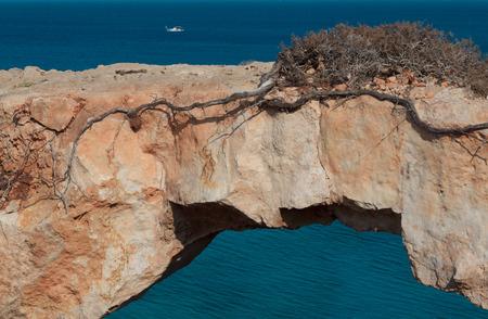 greco: Picturesque view of natural rock bridge at Cape Greco near Ayia Napa, Cyprus, Mediterranean Sea coast.