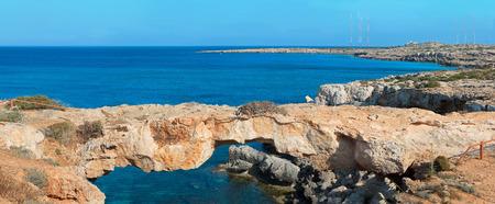 greco: Panoramic view of natural rock bridge at Cape Greco near Ayia Napa, Cyprus, Mediterranean Sea coast.