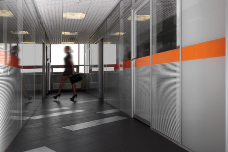 modern office hallway with a silhouette of business woman photo