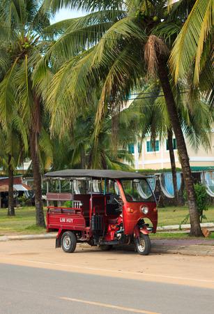 SIHANOUKVILLE, CAMBODIA - NOVEMBER 17, 2014 Tuk-tuk moto taxi parked on the street. Famous asian moto-taxi called tuk-tuk is a landmark of Asia and a popular public transport.