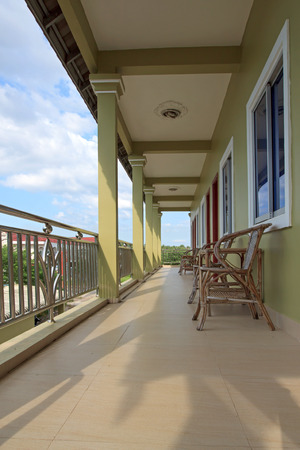 guesthouse: Guesthouse balcony with wooden chairs and tables