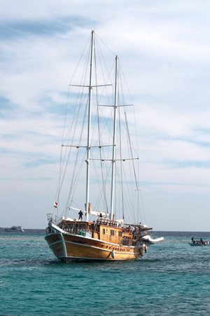 Beautifull old sailboat in the blue sea