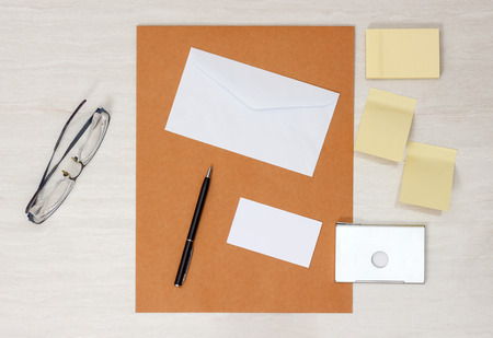 notelet: A set of blank envelopes with paper, pen, glasses, business card ans sticky notes Stock Photo