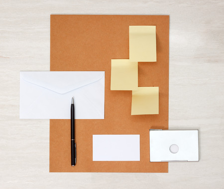 notelet: A set of blank envelopes, sticky notes, business card and pen