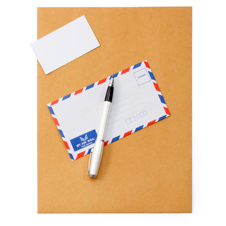 A set of blank envelope, business card and pen photo