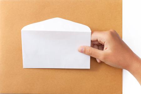 Female hand holding a white envelope photo