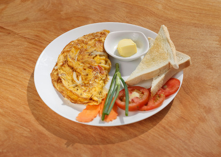 dof: Natural light photo with shallow DOF of vegetable omelette on a wooden table