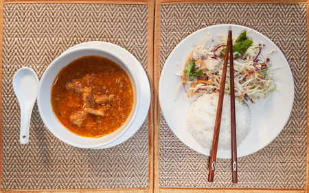 amok: Natural light photo of traditional Cambodian a-mok coconut curry with steamed rice and salad on a wooden table top view