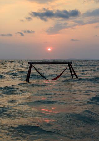 sillhouette: Sillhouette of hammock in sea on sunset in Cambodia