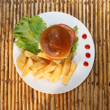 chicken burger: Natural light photo of chicken burger and french fries top view 1 Stock Photo