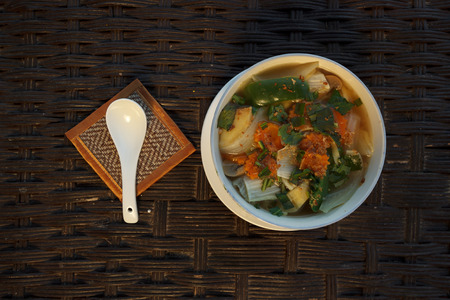 Natural light photo of asian vegetable soup with mushrooms top view photo