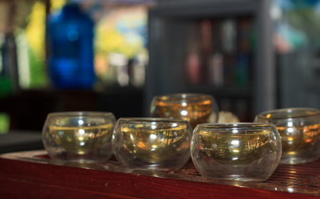 Chinese Tea set with small glass cups on wooden tray closeup photo