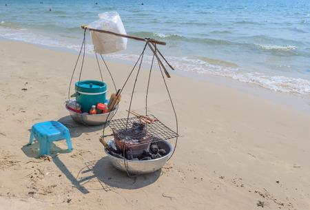 yoke: Asian yoke with fried seafood on the sand at tropical beach