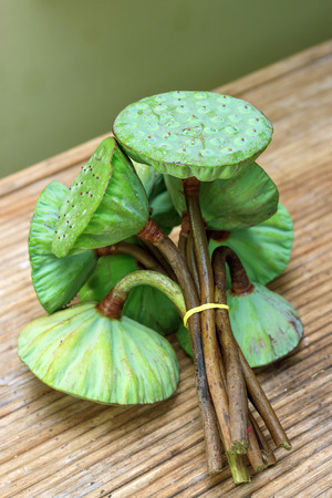 corbel: Bunch of lotus pods on rattan table side view Stock Photo
