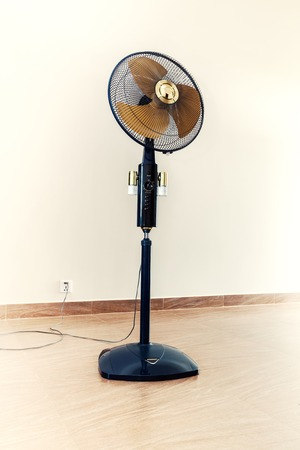 switcher: Special toned photo of large modern electric fan in empty room vertical view 1