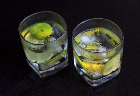 quinine: Lemonade served on a dark marble bar top garnished with a lime view 4