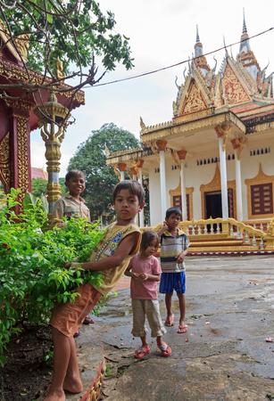 homeless children: SIHANOUKVILLE, CAMBODIA - JUNE 26, 2015: Young homeless children posing in temple Wat Krom in Sihonoukville, Cambodia on June 26, 2015. It is wide spread in Asia that poor homeless children live and work in temples. Editorial
