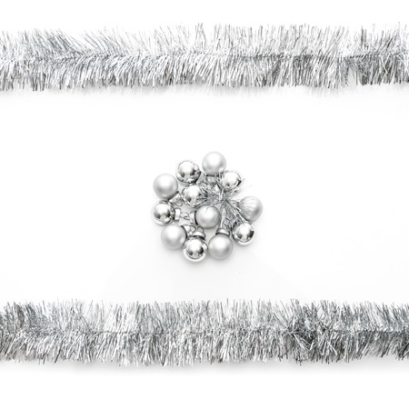 silver frame: New year greeting card made of silver tinsel frame and silver christmas balls