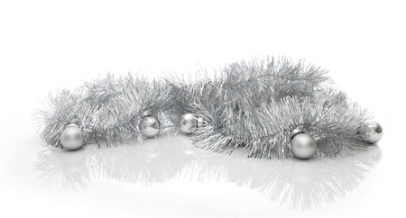 grey scale: Christmas greeting card made of silver tinsel with silver christmas balls, copy space Stock Photo