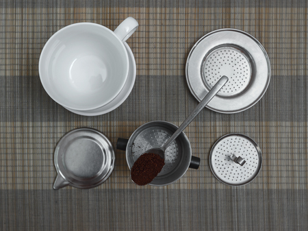 coffee filter: Top view of vietnamese coffee filter ingredients with ready cup of coffee on bamboo placemat, view 3 Stock Photo
