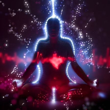 universal enlightenment: Silhouette of a woman in lotus meditation position with shining heart doing kundalini yoga, freezelight photo Stock Photo