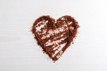 choco chips: chocolate chips arranged into a heart shape against wooden background, horizontal top view Stock Photo