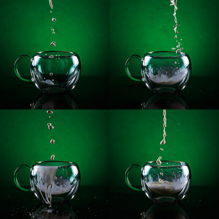 Set of four glass cups against green background. Filling glass cups with milk sequence. Stock Photo