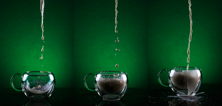 Set of three glass cups against green background. Filling glass cups with milk sequence. Stock Photo