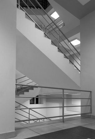 grey scale: Generic view of stairs with metal trailings, grey scale photo