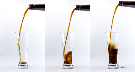 cerveza negra: Set of three beer glasses. Pouring process of dark stout beer into a beer glass, splashes, drops and froth around glass against white background Foto de archivo