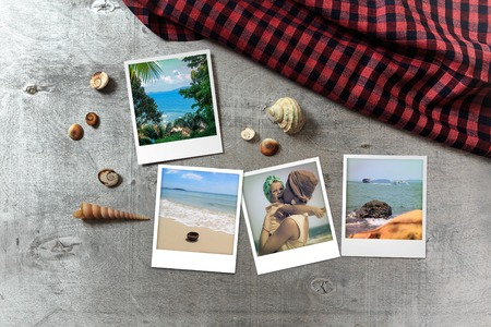 snapshots: Beautiful seaside snapshots arranged on rustic wooden background with seashells and a scarf around, horizontal top view