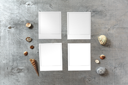 snapshots: Snapshots templates arranged on rustic wooden background with seashells around with copy space, top view Stock Photo