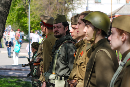 annexation: ULYANOVSK, RUSSIA - MAY 9, 2016: People take part in reconstruction of soviet military uniform at the Immortal regiment on 9 May, 2016 in Ulyanovsk, Russia