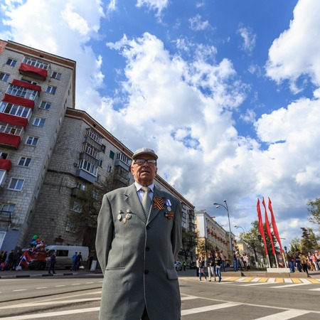 ULYANOVSK, RUSSIA - MAY 9, 2016: An old veteran takes part at Immortal regiment on 9 May, 2016 in Ulyanovsk, Russia