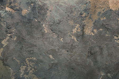putty: Texturized grey and orange putty. Vintage or grungy background of venetian stucco texture as pattern wall.
