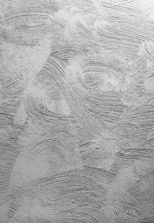 putty: Texturized grey putty. Vintage or grungy background of venetian stucco texture as pattern wall.