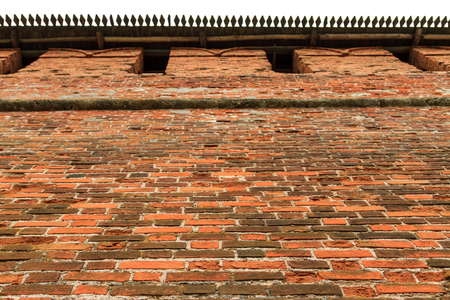 rampart: Old red brick city wall, part of rampart or vallum, horizontal view