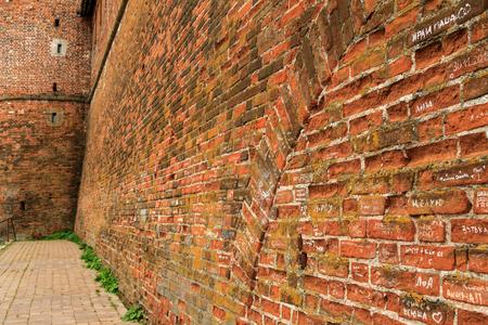 rampart: NIZHNIY NOVGOROD, RUSSIA - OCTOBER 8, 2016: Old red brick city wall, part of rampart or vallum on 8 October, 2016 in Nizhniy Novgorod, Russia