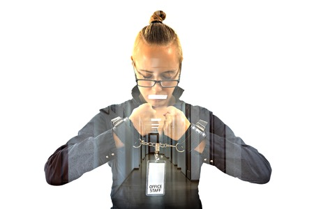 Young beautiful businesswoman with mouth shut with projection of office ceiling lamp as symbol scotch, prisoner of job in cuffs, isolated on white background. Concept of silent dumb anger and job hate Stock Photo