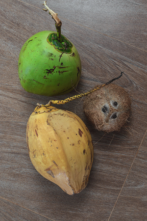 chose: three different coconuts on table, top view Stock Photo