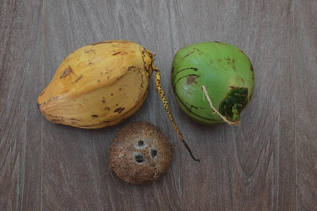 three different coconuts on table, horizontal top view