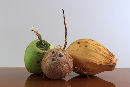 three different coconuts on table, horizontal view